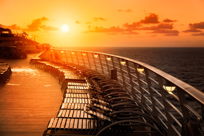 Sunset over deck chairs